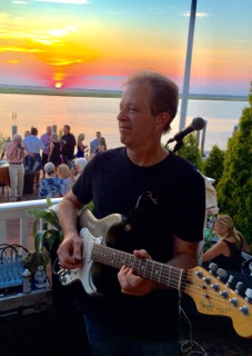 Kit Worton on the deck with guitar