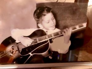 Kit Worton playing his first guitar