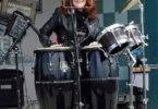 Patricia DelSordo playing congas